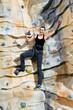 woman on rock wall