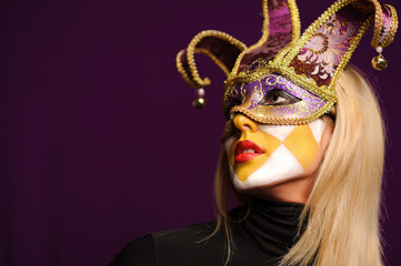 woman in violet carnival mask