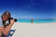 photographer taking photo on beach