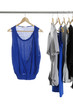blue shirt and Fashion female clothing hanging on hangers