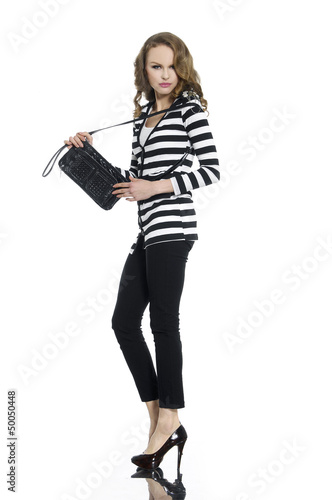 Full body Pretty young woman in stripy shirt with bag posing
