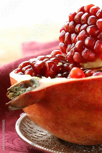 pomegranate ripe fruit  on a silver plate