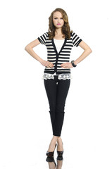 Full body young woman in stripy t-shirt and jeans