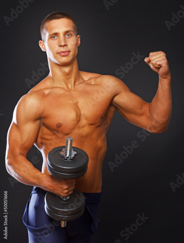 Athlete is demonstrating his well trained body