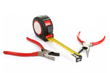 red pliers and measuring tape isolated on white