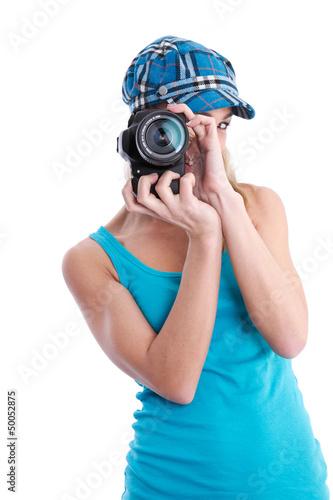 Fotografin isoliert in Blau mit Spiegelreflexkamera