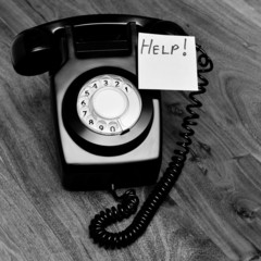Black and white telephone with customer service concept note