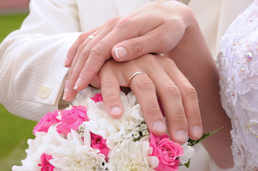 Wedding flower banch with newlyweds hands