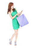 happy young woman shopping on the internet by tablet pc