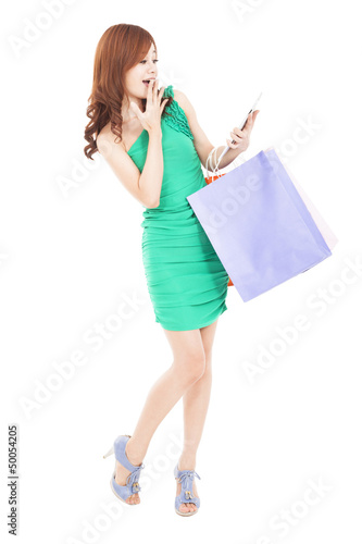 surprised young woman looking tablet pc and shopping on the inte