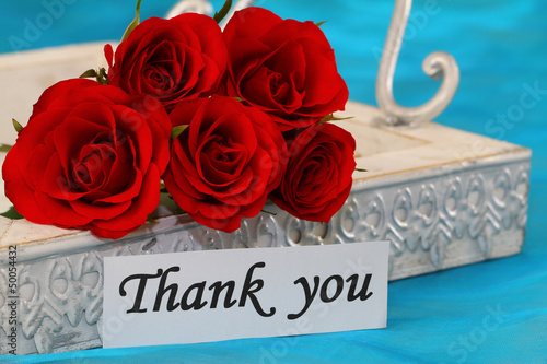 Thank you note and red roses on vintage tray