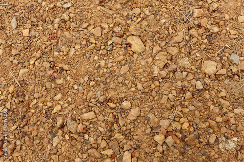 brown ground soil texture mixed with small rocks