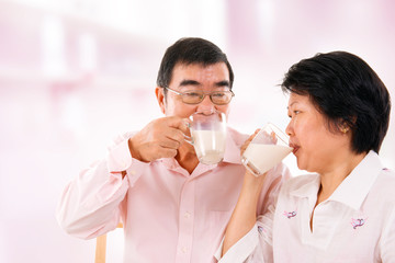 Asian mature couple drinking soy milk