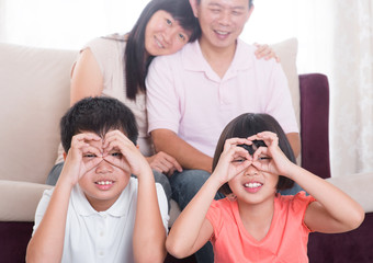 Southeast Asian family at home
