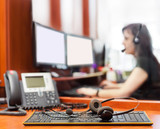 call center with young woman and headpones