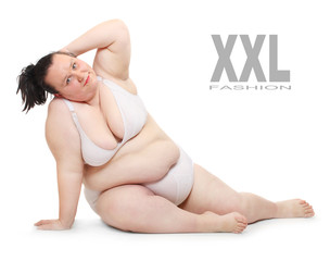 Overweight woman dressed in bikini on a white background.