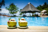 Fototapety Pina colada drink in front of pool