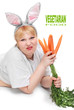 Funny woman with fresh carrot.