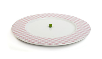 Plate with peas white isolated