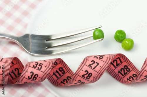 Plate with peas and centimeter measure