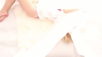 Beautiful blonde in white bed, seen from above