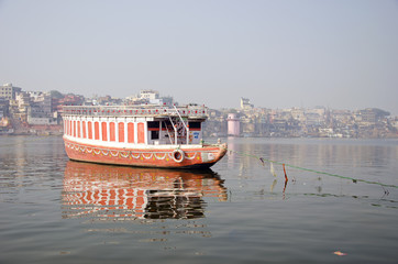 boat on Ganga river in sacred Varanasi city, India