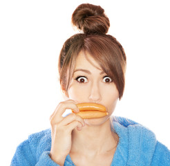 Woman with sausages simulating lip enhancement