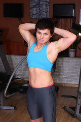 Athletic brunette woman in gym