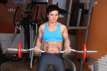 Young woman with barbell