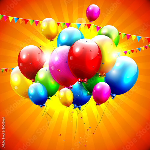 Flying colorful balloons on orange background