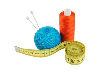 Yellow measuring tape and threads isolated on white