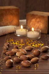 seeds of argan with yellow cosmetic pearl