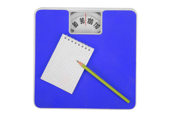 Scales and a notebook with a pencil. Sports Concept. Isolated,