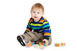 baby playing with wooden toy cubes with letters. Wooden alphabet