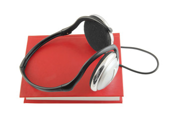 Audio book with headphones isolated on white background