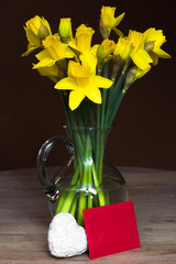 Lent lily daffodil in a glass vase with letter