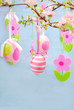 easter decoration with hanging eggs and felt flowers