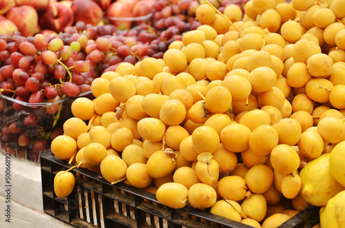 Close up of  fresh dates and  grapes on market stand