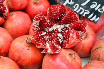 pomegranates on market stand