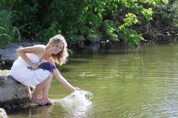 girl squirting water at the lake