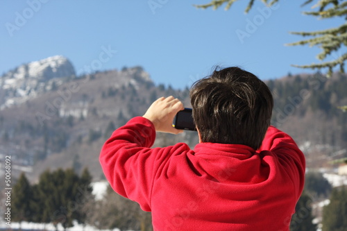 boy in red sweater that he photographed the Summit of a mountain