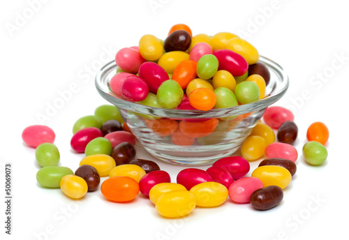 egg-shaped candies in a glass bowl