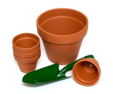 green garden showel and ceramic pots