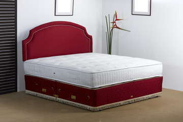 Luxury bedding mattress in a set up bedroom atmosphere