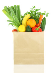 Fresh vegetables and fruits in a paper grocery bag