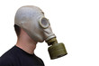 Man with old style gas mask isolated on white background, side v