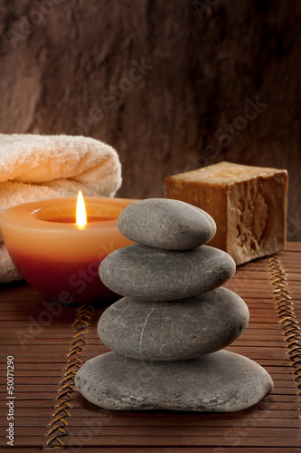 SPA atmosphere with four stones with candle light and soap