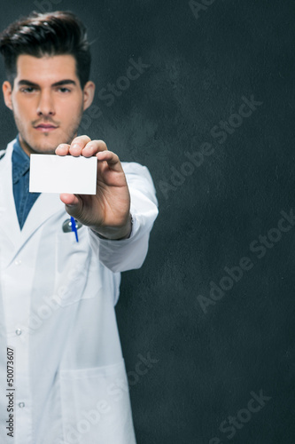 Doctor offering us his business card