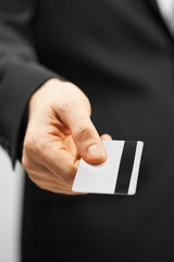 man in suit holding credit card