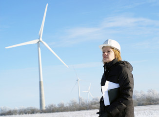 female engineer with wind turbines